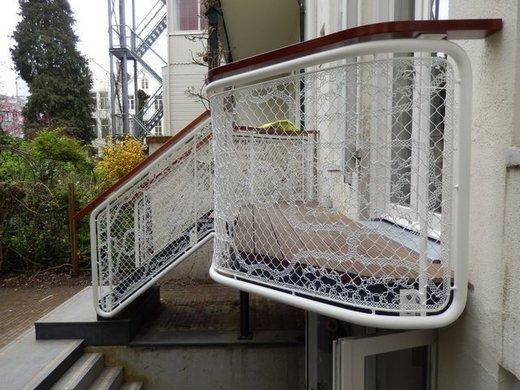 Buitentrap met design balustrade